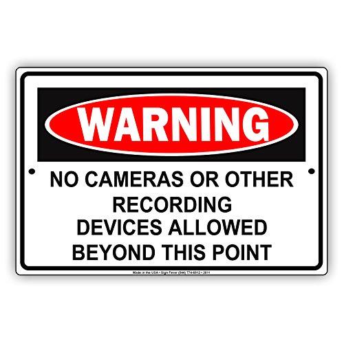 Waarschuwing Geen camera's of andere opname-apparaten toegestaan voorbij dit punt beperking Let op aluminium metalen bord