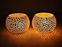 The holders sparkle and glow when the tea light is added, giving a warm and romantic light. These tea light holders come in a box of two as if we sold them individually it would cost almost as much to post as it would to buy - 2 presents in one!! The...