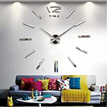 ساعة حائط فضية كبيرة الحجم
