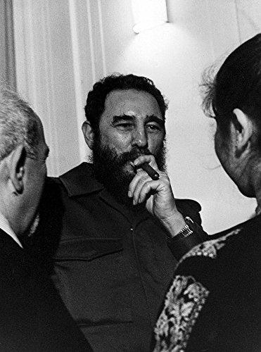 Fidel Castro smoking a cigar Photo Print (8 x 10)