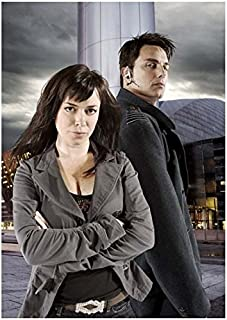 Torchwood John Barrowman is Captain Jack with Eve Myles as Gwen Cooper Serious 8 x 10 Photo