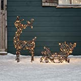 Renna luminosa con slitta natalizia in vimini