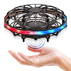 ULTRA BRIGHT LED SCOOT DRONE: This hand operated drone for kids features super-bright LEDs that light up this UFO flying toy with red, white and blue; great beginner drone for kids EASY TO FLY KIDS DRONE THAT FLIPS: These hand controlled drones use i...