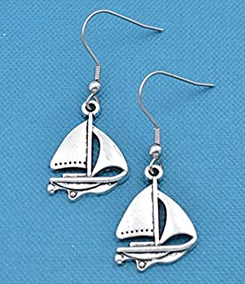 Sailboat earrings in silver toned metal. Sailboat earrings. Sailboating gifts. Boating jewelry. Boating gifts. Sailboating gifts.