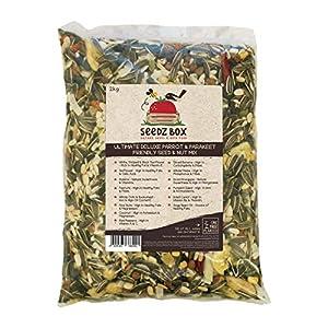 SeedzBox Mezcla Premium semillas y frutas para agapornis, ninfas y loros. Comida equilibrada –con plátano, pipas de calabaza, cacahuetes y avena. Alta calidad y saludable. Aceites y fibra. Bolsa 2kg