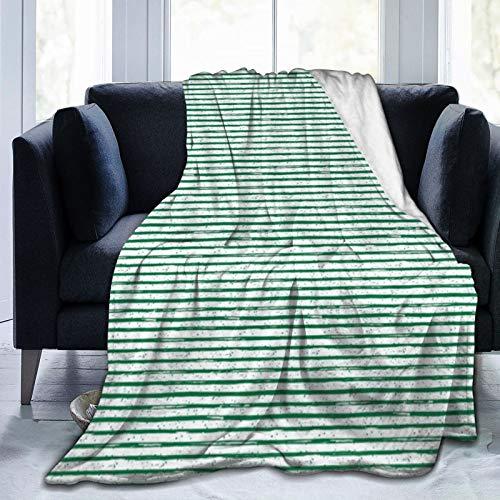 Manta de forro polar ultra suave con rayas verdes brillantes para sofá o cama.