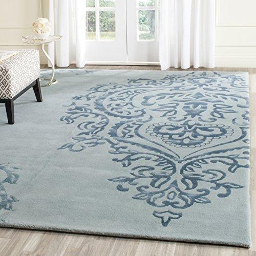Safavieh Isaac Mizrahi Collection IMR720C Handmade Premium Wool Area Rug, 4' x 6', Ivory / Blue
