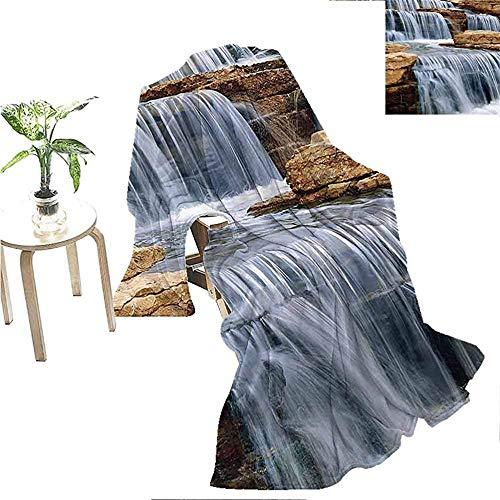 QDAS Wasserfall-Sammlungsplüsch, der über Felsen landschaftlich landschaftlich Sofadecke Elfenbeinweiß kaskadiert
