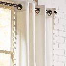 Mila Pompom Ivory Grommet Curtain | Pier 1 Imports