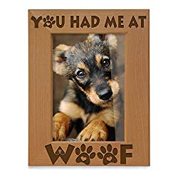 "Wooden picture frame with the words ""You had me at woof"" engraved on the front."