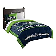 """Features NFL team helmet above team name and logo; background is bold team color Soft, cozy and warm; set comes with comforter and sham Comforter measures 64""""W x 86""""L; Sham measures 24""""W x 30""""L Comforter: Machine wash cold separately using delicate c..."""