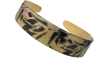 Caravan Gold Combined With Black Hand Strokes Creates This Electric Headband