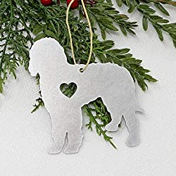 A Christmas ornament of a metal diecut Goldendoodle dog with heart-shape, photo
