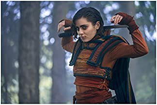 Into the Badlands Ally Ionnides as Tilda resting arms behind head on sword 8 x 10 Inch Photo