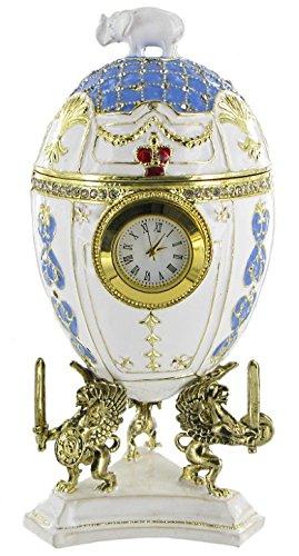 Hübsches Schmuck Ei im Stil Fabergés, goldfarben aus emailliertem Metall mit Uhr und Spieluhr - Zauberflöte (Mozart)