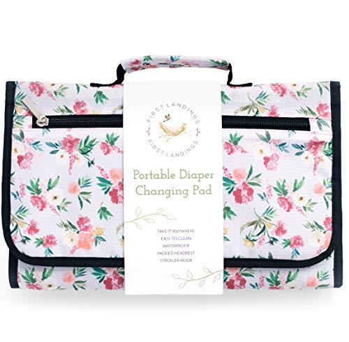 Portable Diaper Changing Pad by First Landings | Convenient, On The Go Baby Change Mat with Head Cushion | Changing Station with Pockets for Diapers and Wipes | Travel Changing Mat for Diaper Bag