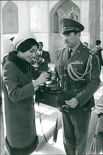 Vintage photo of Farah Pahlavi is brought a filmcamera during Baudouin of Belgiums visit to Iran