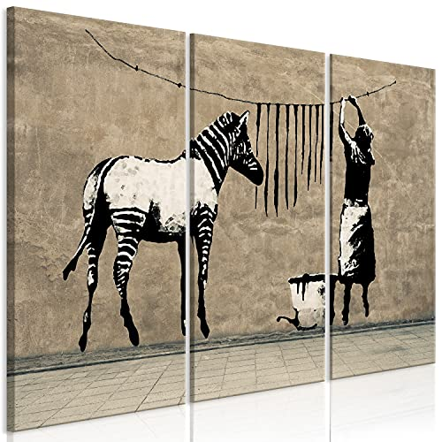 murando - Cuadro en Lienzo Banksy Washing Zebra 120x80 cm impresión de 3 Piezas en Material Tejido no Tejido - Cuadro de Pared Foto impresión fotografía Graffiti Street Art Animales i-C-0151-b-e