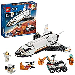 This building set features a space research shuttle with opening cockpit, two large opening doors and space inside for a storage drone Includes two astronaut minifigures to drive the Mars rover with (for-June-2019) articulated grappling arm, laser an...