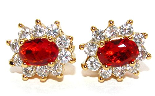 AH! JEWELLERY RUBY STUDS. 12 BEAUTIFUL BRILLIANT ROUND FINEST LAB DIAMONDS SURROUNDING A STUNNING RUBY OVAL LAB DIAMOND. 24CT GOLD ELECTROPLATED. ENCHANTING FASHION EARRINGS. HIGH REMARKABLE QUALITY.