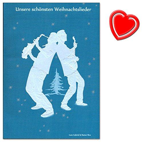 Onze mooiste kerstliedjes - notenboek met liedteksten voor gitaar of piano en tot 4 stemmen (in C) of saxofoon (b of bb) - met kleurrijke hartvormige notenklem