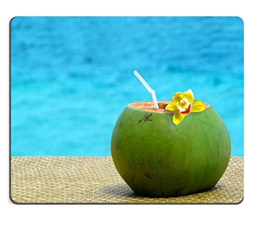 MSD Natural Rubber Gaming Mousepad IMAGE ID: 38695677 Fresh coconut juice with a drinking straw by the swimming pool