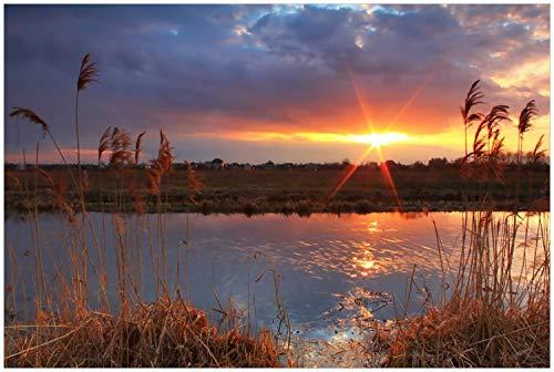 Wallario Glasbild Sonnenuntergang über dem Fluss, Gräser im Wind - 60 x 90 cm in Premium-Qualität: Brillante Farben, freischwebende Optik