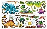 dekodino Wandtattoo Dinosaurier Set mit Bäumen und Steinen Wandsticker Deko