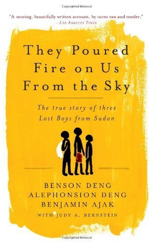 They Poured Fire on Us From the Sky: The True Story of Three Lost Boys from Sudan New Edition by Benjamin Ajak, Benson Deng, Alephonsion Deng, Judy A. Bernst (2006) Paperback