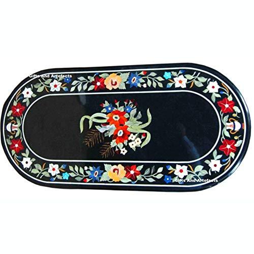 Gifts and Artefakte Couchtisch, ovale Form, schwarzer Marmor, Mehrfarbig, Halbedelsteine, Inlay, Handwerkskunst, hergestellt von qualifizierten Kunsthandwerkern, 61 x 122 cm