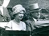 Queen Elizabeth and the Duke of Edinburgh are pictured arriving at the Golden Gates for the Royal Ascot race meeting - Vintage Press Photo