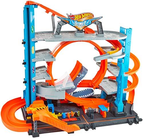 Hot Wheels FTB69 Garage delle Acrobazie Playset con Pista Connettibile per Macchinine, Loop a Doppia Corsia, Ascensore e Squalo per Stimolare Fantasia, Giocattolo per Bambini, dai 5 + Anni,