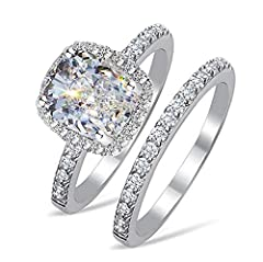 **PLEASE MAKE SURE SELLER IS VenetiaDiamond TO RECEIVE OUR AUTHENTIC PRODUCTS* Don't buy from Shree International who hijacked our listing! Contemporary halo designer ring set, featuring a 2 carats 7x8mm) radiant cut simulated diamond, framed by spar...