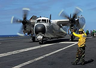 Posterazzi Poster Print Collection a Sailor Gives Hand Signals to the Pilot of a C-2A Greyhound Stocktrek Images, (34 x 22), Multicolored