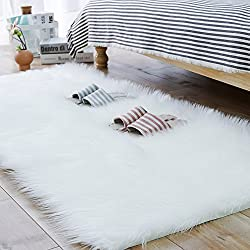 Faux sheepskin mat in white color.