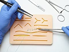 """PRACTICE STITCHING WOUNDS This 7.25"""" x 5.25"""" Suture Pad gives you a range of different incisions and wounds of various depths and types to practice suturing REUSABLE UP TO 100 TIMES Designed to be robust, this suture practice kit can be used up to 10..."""
