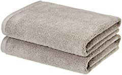 Bath towel measures 54 by 30 inches Made of 100% cotton for softness and tear-resistant strength Lightweight; quickly absorbs moisture for a cozy feel; attractive solid color Simple band and border detailing adds visual interest whether folded or han...
