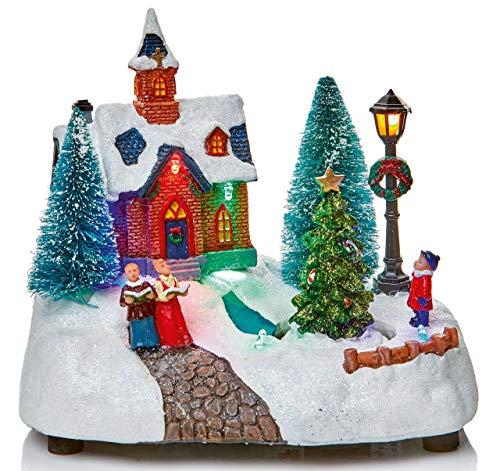 Scene di neve di villaggio tradizionale animate di Natale a LED multicolore con rotazione dell'albero e cantanti di Natale