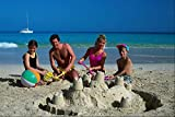 732077 Family Building Sand Castle On Beach Fuerteventura