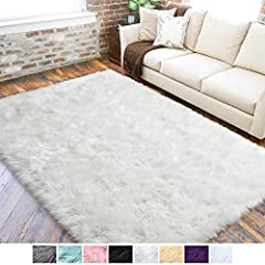 PREMIUM FAUX SHEEPSKIN RUG: LOCHAS faux fur rug is features a top layer of fluffy material, which is extremely soft to the touch and warm. The superior fabric provides the fur rug with exceptional comfort and luxurious. DURABLE AND STRONG BACKING: Th...