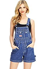 Twill short overalls with a multi pocket bib with logo patch. Traditional straps with clasp closures. Pockets on the sides and back with  triple button closures at the sides. Vintage fit is slightly oversized. Looks great paired with crop tops. Machi...
