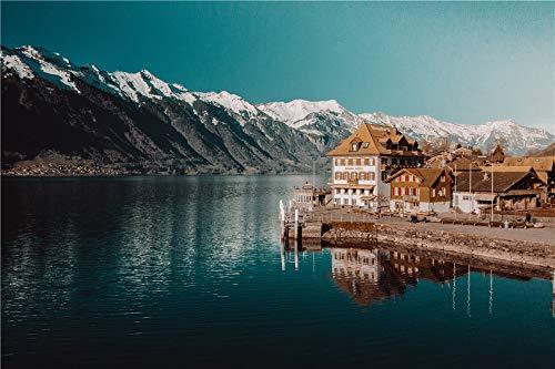Puzzles para Adultos 1000 Piezas Edificio De Hormigón Blanco Y Marrón Junto Al Cuerpo De Agua Cerca De La Montaña Rocosa Nevada Bajo Un Cielo Azul Claro