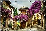 Wallario Garten-Poster Outdoor-Poster, Malerische Stadt in der Provence mit bunten Blumen in Premiumqualität, für den Außeneinsatz geeignet