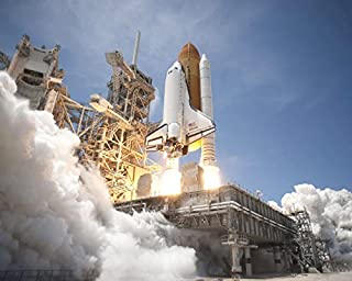 An exhaust plume forms under the mobile launcher platform on Launch Pad 39A as space shuttle Atlantis lifts off into orbit Poster Print by Stocktrek Images (17 x 11)