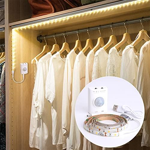 Aigostar - Tira LED de 1m con sensor de movimiento. Luz cálida 3000K, IP65 impermeable, batería recargable USB. Tira LED autoadhesiva, para dormitorios, salón, cocina, armarios y decoración.