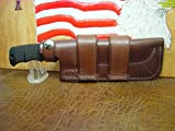 Custom Made Cross Draw Knife Sheath That Will fit The SOG Seal pup Light Brown. A lot of Leather for The Price and can be Worn on The Left or Right Hand Side. Sheath only.