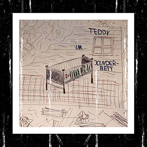 Teddy im Kinderbett
