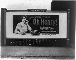 HistoricalFindings Photo: Billboard Showing a Woman Eating an Oh Henry Candy bar,1923,Thomas Cusack