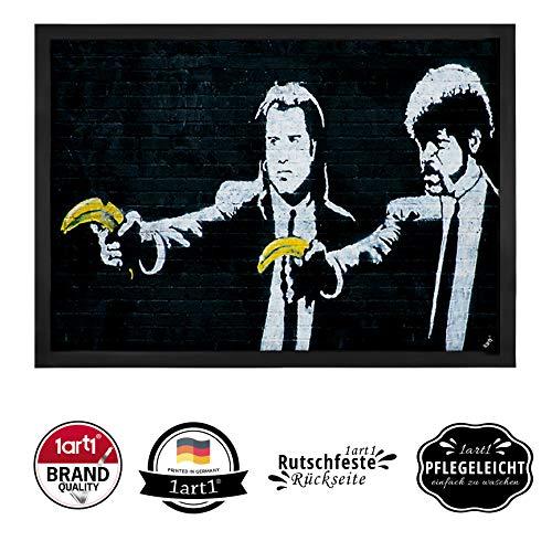 1art1 Robin Banksy lustige Fußmatte | Fußmatte Innenbereich und Außenbereich | Türmatte lustig | Bananen-Pistole | Design Fußmatte 50 x 70 cm