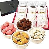 【商品内容】Terraris(テラリス) 4種の贅沢ナッツチョコレート12袋詰め合せギフトセット。4種のナッツを詰め合せたナッツチョコは当店のみのオリジナルギフト。お手土産にも贈り物にも、またお返しやお祝いにも喜ばれる高級感のあるパッケージで、配れる個包装タイプで非常に評価の高い商品です。 【内容量】アーモンドココアチョコ3袋、ピーカンナッツキャラメルチョコ3袋、ウォールナッツ(くるみ)ホワイト岩塩チョコ3袋、カシューナッツいちごチョコ3袋の各種18g×3袋=合計12袋詰合せセット。 【特徴】「...